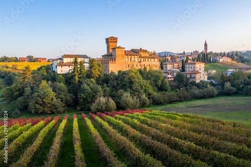 Levizzano Rangone Castle, with vineyards, during autumn. Modena province, Emilia Romagna, Italy - 299139224