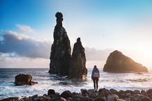 Beautiful Coast View During A Sunset With Young Man Standing Against Rocks. Ilheus Da Ribeira Da Janela - Madeira, Portugal. Madeira, The Portuguese Island Of Eternal Spring.