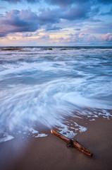 Fototapeta Morze Scenic sunset on a beach in Miedzyzdroje, long time exposure, Poland.