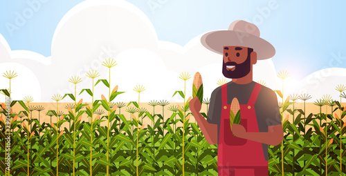 man farmer holding corn cob african american countryman in overalls standing on Fototapet