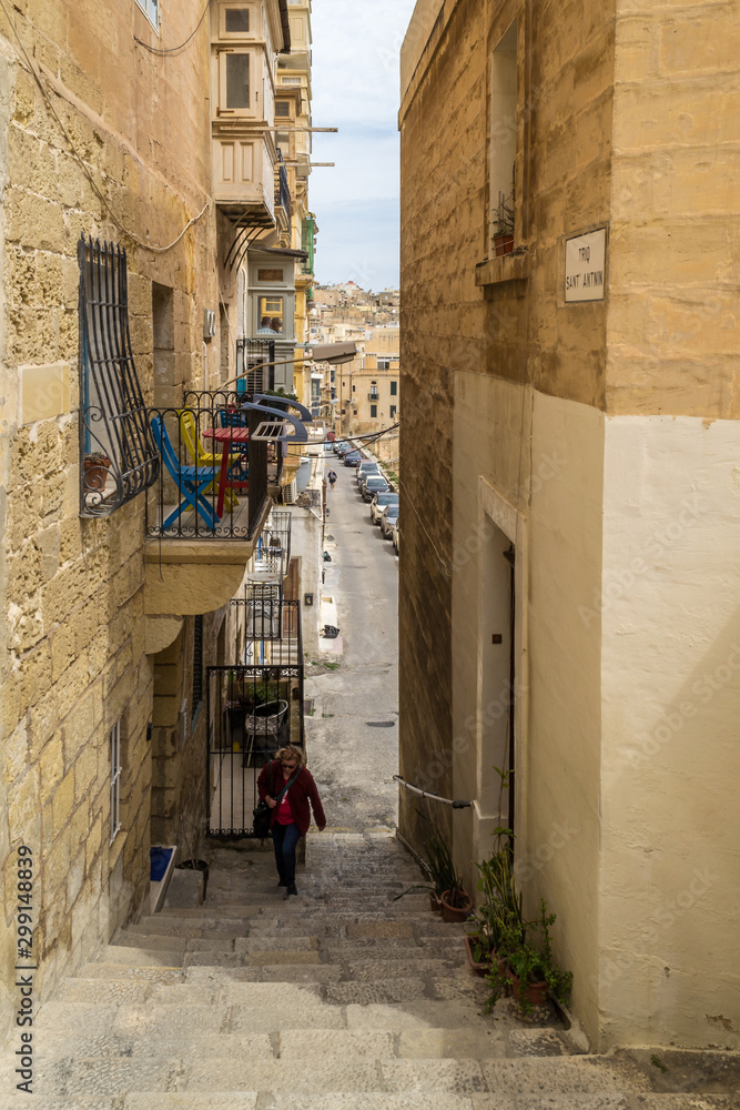 Narrow street surrounded by old tenement houses, Malta.