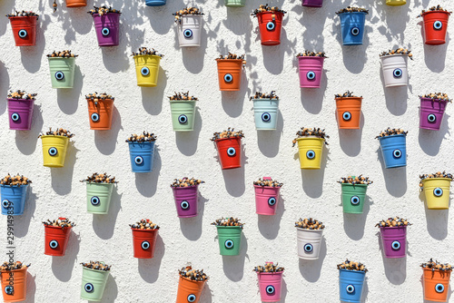 Valokuvatapetti Multi-colored buckets with blue eyes (Nazar Boncuk amulets in Turkish culture) o