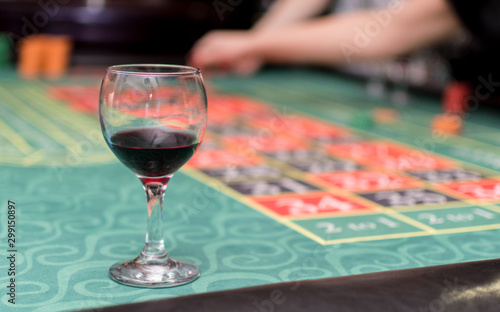 Recess Fitting Alcohol A glass of red wine on the table of an underground casino.