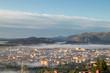Oviedo city aerial panoramic sunrise foggy view from a mountain viewpoint near Oviedo, Spain