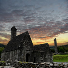 View To The Ruins Of Monastic Cemetery Of Glendalough, Ireland While Sunset , Ancient Monastery In The Wicklow Mountains With A Beautiful Graveyard From The 11th Century