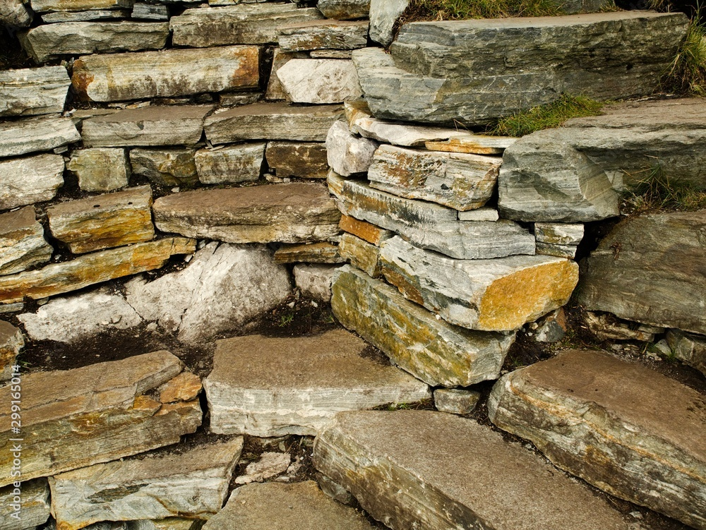 Dry stone wall texture background, traditional way of building fences.
