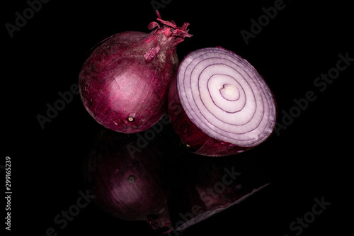 Group of one whole one half of tasty onion red isolated on black glass Fototapete