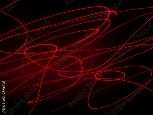 Photo Red lines on a black background. hellish background