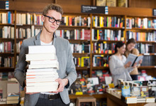 Guy With Stack Of Books In Hands
