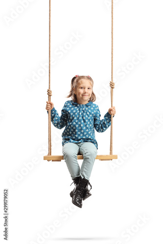 Fototapety, obrazy: Happy little girl sitting on a wooden swing