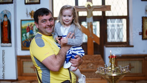 Photo Father with baby on the christening ceremony