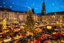 People Visit Christmas Market Striezelmarkt In Dresden, Germany
