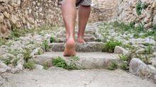 Male Bare Feet Climb Old Stone Steps