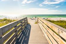 Wooden Boardwalk To Indian Rocks Beach In Florida, USA