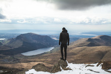 Man Stood On Mount Snowdon In The Snow Wales United Kingdom