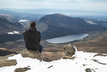 Man Sat On Mount Snowdon In The Snow Wales United Kingdom