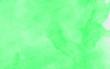 Leinwandbild Motiv Abstract bright light green watercolor painted paper textured effect background. Subtle spring shades aquarelle illustration for grunge design, vintage card template