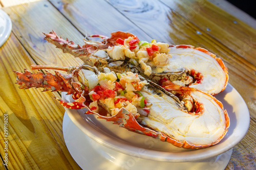 Photo Caribbean lobster slice in the grill, Puerto Rico traditions seafood plate