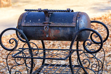 Metal Grill With Twisted Wrought Iron Curly Handles.