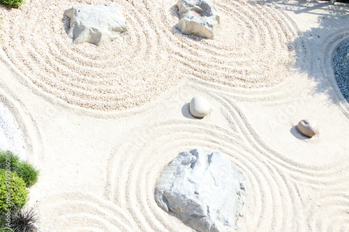 Poster Stenen in het Zand Zen garden pattern on sand and stone. Top view. Meditation and harmony.