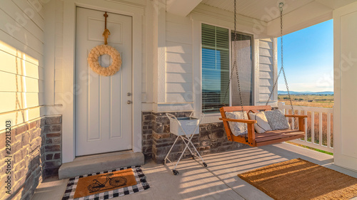 Obraz Panorama frame Front porch of modern home with swinging chair - fototapety do salonu