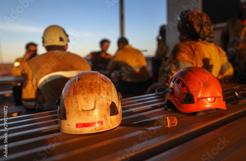 Red rope access miner safety helmet head protection place on the table mine site Canvas Print