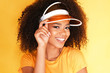 Leinwanddruck Bild The cute afro-american model with a big shine smile isolated on orange background.