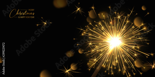 Merry Christmas background with realistic sparkler and light effects Canvas Print