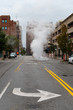 Steaming manhole in City