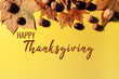 canvas print picture - Happy Thanksgiving Day with maple leaves and nut on yellow background