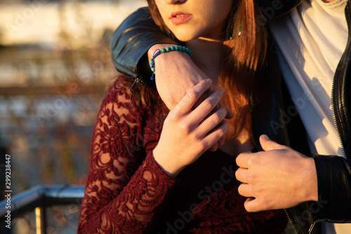 Fotomural  Woman and man close up of hands with part of womans face showing