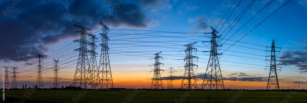 Fototapeta High voltage electricity tower sky sunset landscape,industrial background.