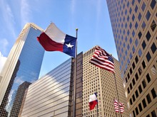 Low Angle View Of United States Of America Flag And Texas State Flag In Front Of Modern Skyscrapers In Downtown Houston (skyline / Skyscrapers) On A Summer Day - Houston, Texas, USA
