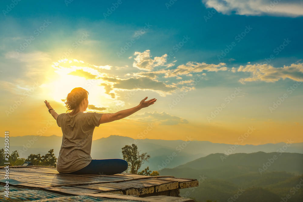 Fototapeta Healthy woman lifestyle balanced practicing meditate and zen energy yoga outdoors on the bridge in morning the mountain nature. Healthy life Concept.