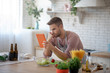 Leinwandbild Motiv Bearded husband watching culinary video on tablet