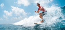 Young Caucasian Man Surfs The ...