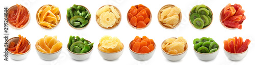 Fototapeta Bowls with different dried fruits on white background