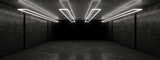 White neon lamps in a dark tunnel. Reflections on the walls.