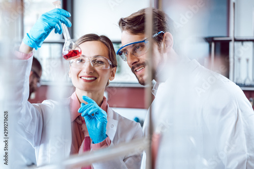 Fotomural  Two chemical scientists during breakthrough experiment