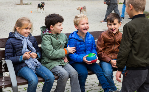 Kids playing ball together on the street - 299278698