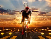 Man Racing Cyclist On Runway