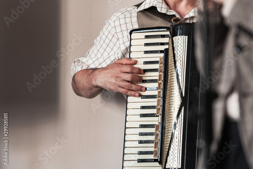 Vászonkép  Accordionist plays vintage accordion