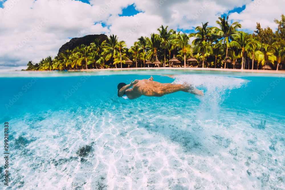 Fototapety, obrazy: Young attractive woman swimming underwater in transparent ocean. Mauritius, Le Morne
