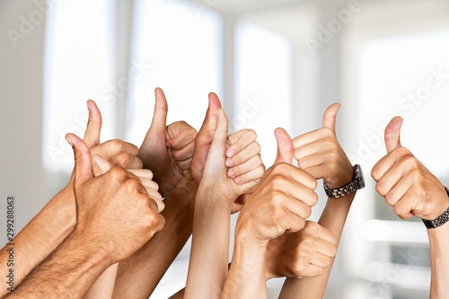 Obraz Group of people hands showing thumbs up signs on background - fototapety do salonu