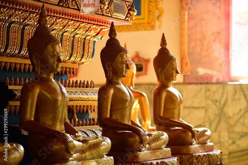 Spoed Fotobehang Bedehuis Golden statue of buddha in temple, Thailand