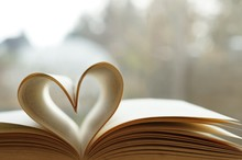 Heart From Page Of Book For Valentine's Day Concept With Blurred Bright Light Background And Vintage Tone