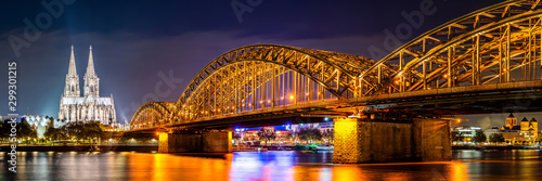 Panorama of the Hohenzollern Bridge over the Rhine River and Cologne Cathedral by night - 299301215