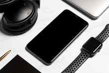 Flat Lay Shot Of Techno Items For Modern Worker With Smartwatch Mobile Phone And Wireless Headphones