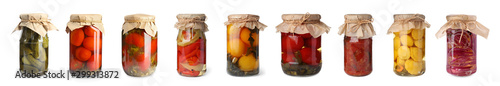 Set of glass jars with different pickled vegetables on white background Fototapeta