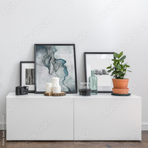 White sideboard and decorative accessories Fototapet